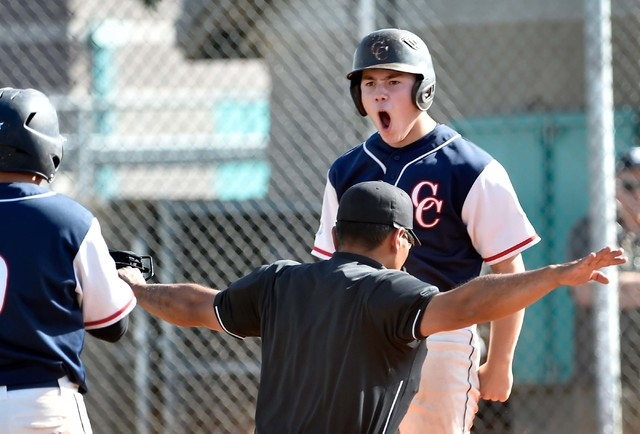 Coronado High School's Nate Ruiz reacts after sliding safely across home plate during a first round game in the Sunrise Region baseball tournament against Silverado at Silverado High School on Tue ...