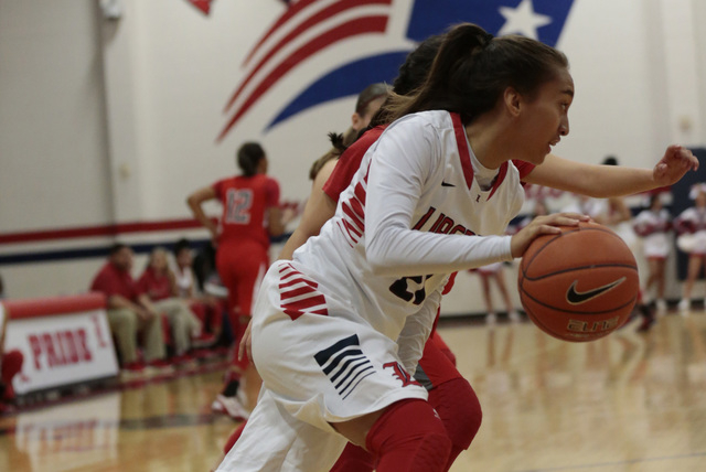 Liberty's Kaily Kaimikaua (21) handles the ball Monday in a home game against Arbor View. Kaimikaua made three 3-pointers in the first half of the Patriots' 59-41 win. (Donavon Lockett/Las Vegas R ...