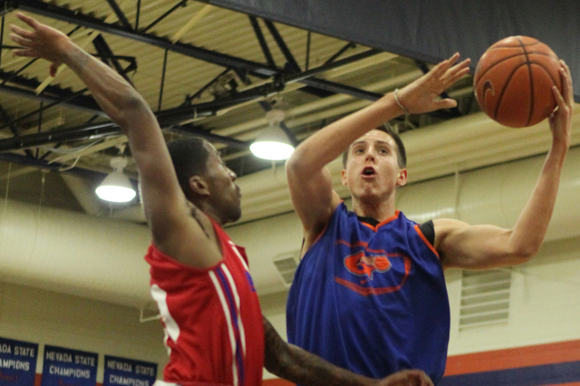 Bishop Gorman's Zach Collins (12), right, goes up for a shot during their scrimmage game against Valley at Bishop Gorman High School in Las Vegas Tuesday, Nov. 25, 2014. (Erik Verduzco/Las Vegas R ...