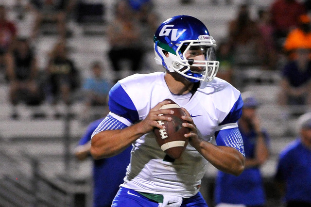 Green Valley quarterback Christian Lopez back peddles to pass during a high school football game against Palo Verde at Palo Verde High School on Friday, Sept. 5, 2014. (Photo by David Becker/Las V ...