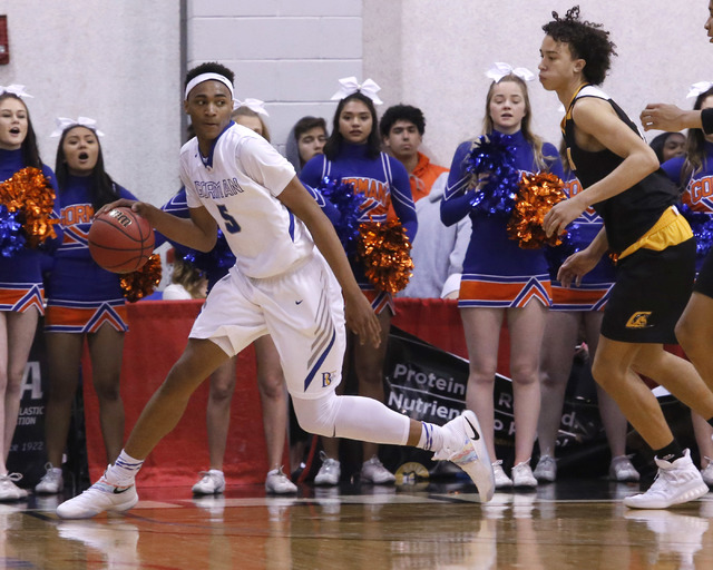 Bishop Gorman's Chuck O'Bannon (5) looks for a pass during the second half of a Class 4A boys state final game at the Cox Pavillion on Friday, Feb. 24, 2017, in Las Vegas. Bishop Gorman won 62-58. ...