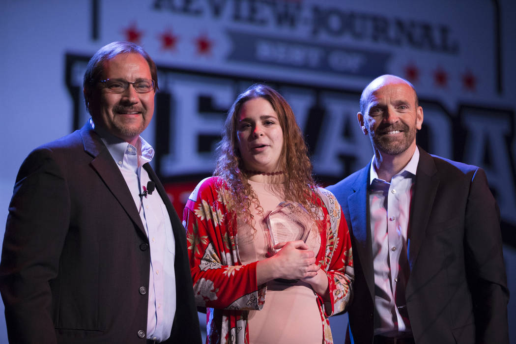 Joelle Beachler, center, is presented with the No Limits Award, by Bill Bradley, left, sports editor for the Las Vegas Review-Journal, and Simon Keith, during the annual Best of Nevada Preps Award ...