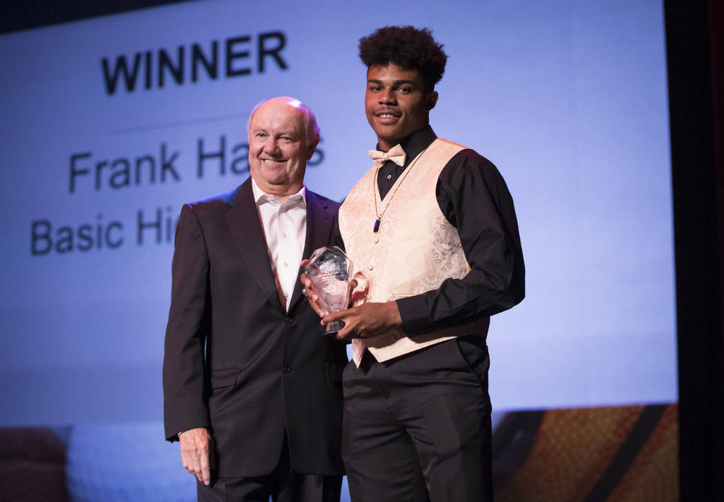 Frank Harris, right, of Basic High School is presented the Male Athlete of the Year Award by Craig Moon, publisher for the Las Vegas Review-Journal, during the annual Best of Nevada Preps Awards a ...