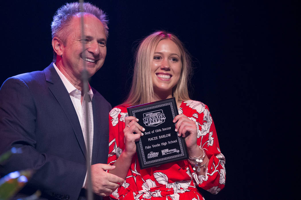 Macee Barlow of Palo Verde High School, right, is presented with the Female Soccer Athlete of the Year Award by John Barr during the annual Best of Nevada Preps Awards at the Venetian hotel-casino ...