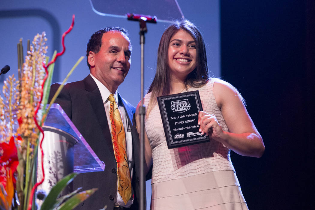Sydney Berenyi of Silverado High School, right, is presented with the Female Volleyball Athlete of the Year Award by Kevin Janison, meteorologist for NBC Las Vegas, during the annual Best of Nevad ...