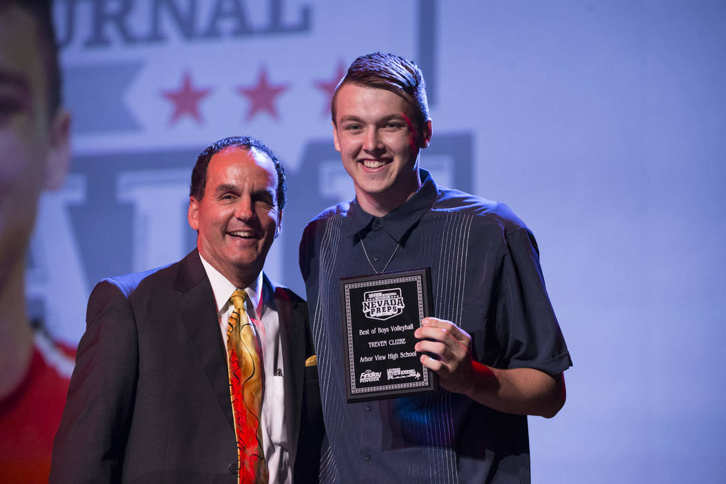 Treven Clizbe of Arbor View High School, right, is presented with the Male Volleyball Athlete of the Year Award by Kevin Janison, meteorologist for NBC Las Vegas, during the annual Best of Nevada  ...