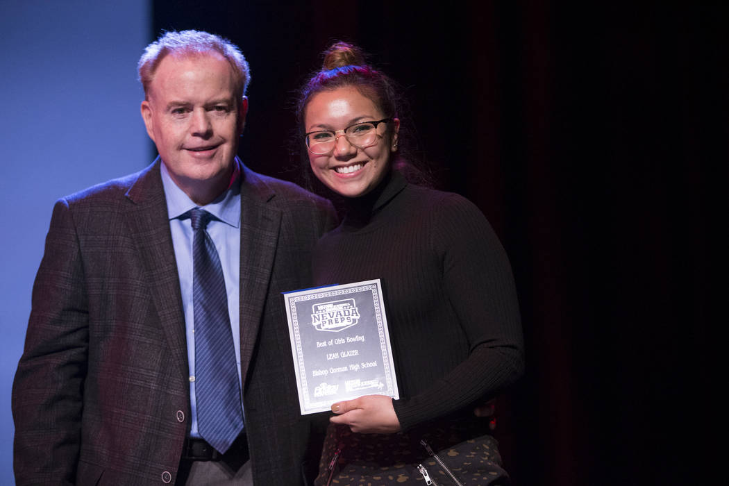 Leah Glazer of Bishop Gorman High School, right, is presented with the Female Bowling Athlete of the Year Award by Ed Graney, sports columnist for the Las Vegas Review-Journal, during the annual B ...