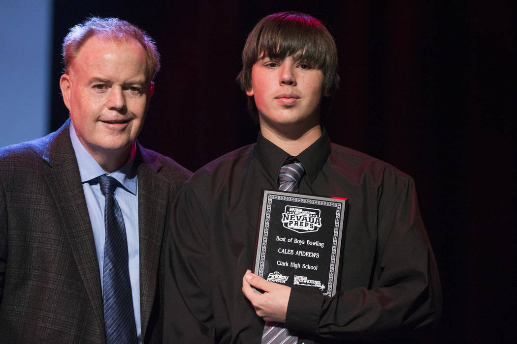 Caleb Andrews of Clark High School, right, is presented with the Male Bowling Athlete of the Year Award by Ed Graney, sports columnist for the Las Vegas Review-Journal, during the annual Best of N ...