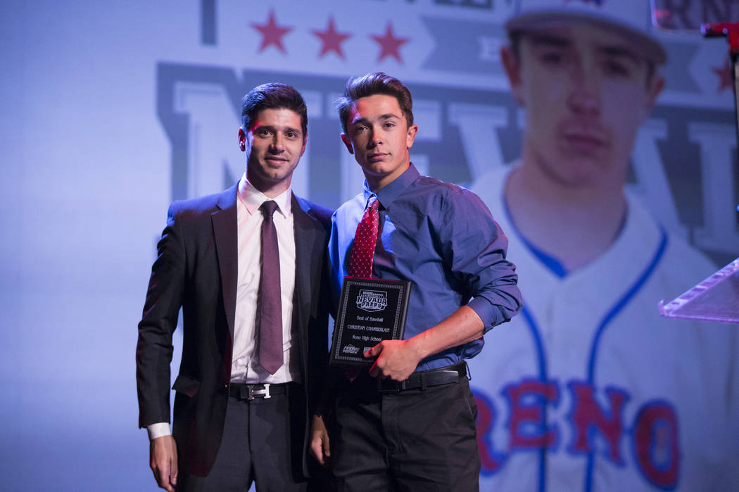Christian Chamberlain of Reno High School, right, is presented with the Baseball Athlete of the Year Award by Nick Pomponio during the annual Best of Nevada Preps Awards at the Venetian hotel-casi ...
