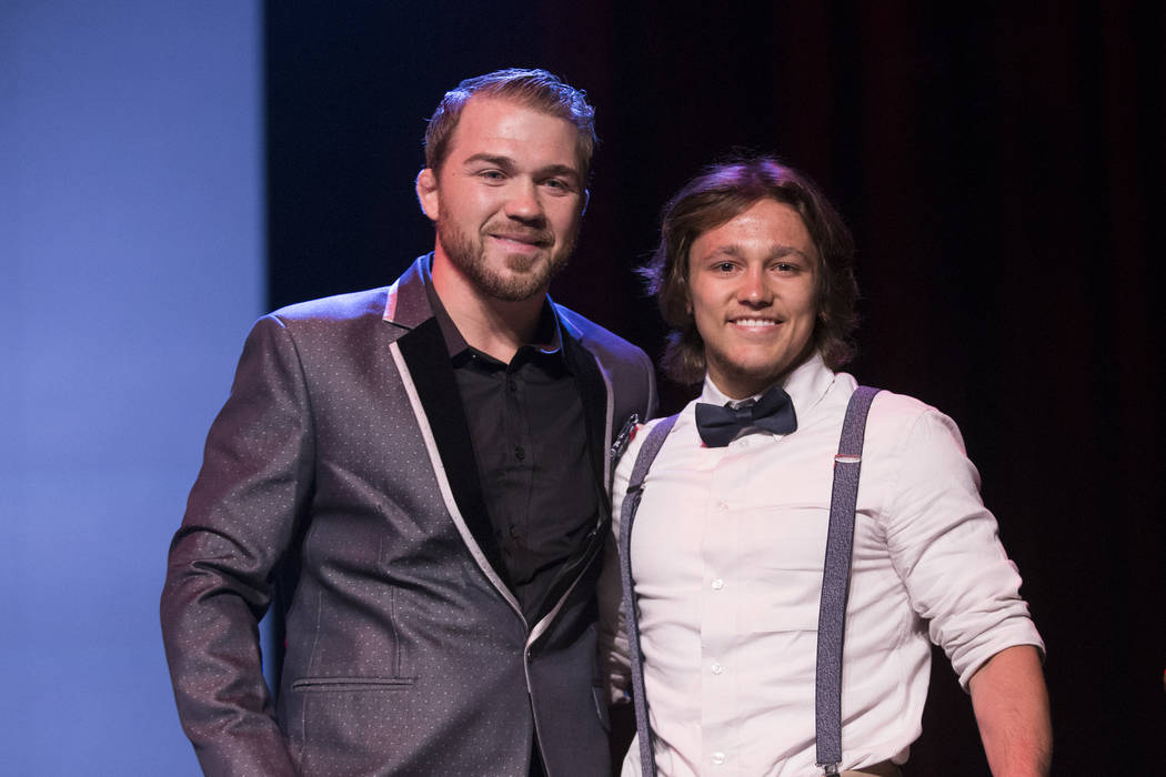 Ian Timmins of Wooster High School, right, is presented with the Male Wrestling Athlete of the Year Award by Bryan Caraway during the annual Best of Nevada Preps Awards at the Venetian hotel-casin ...