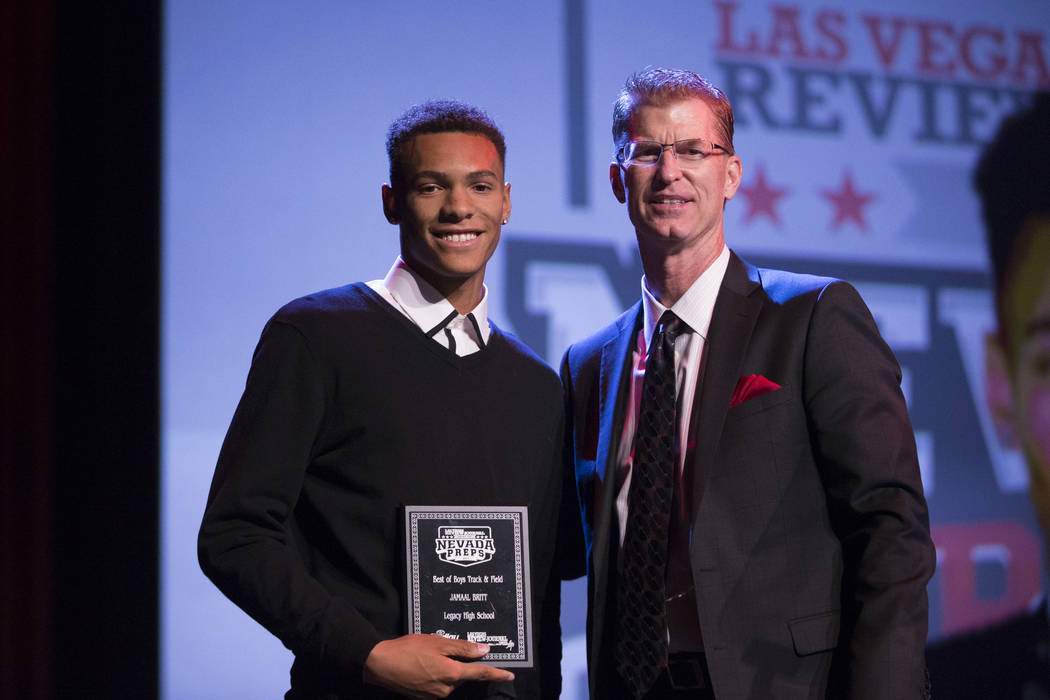 Jamaal Britt of Legacy High School, left, is presented with the Male Track and Field Athlete of the Year Award by Steve Stallworth, general manager of the South Point Arena, during the annual Best ...