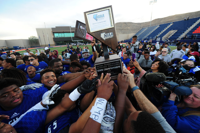 Desert Pines players celebrate their 39-6 win over Spring Creek during the NIAA Class 3A State championship game at Bishop Gorman High School in Las Vegas Saturday, Nov. 19, 2016. Josh Holmberg/La ...