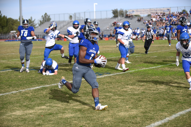 Desert Pines Isaiah Morris (7) runs the ball in for a touch down against South Tahoe during their 3A state semifinal football game played at the Desert Pines football field in Las Vegas on Saturda ...