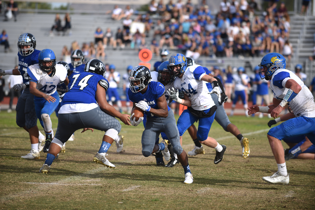 Desert Pines Isaiah Morris (7) runs the ball against South Tahoe during their 3A state semifinal football game played at the Desert Pines football field in Las Vegas on Saturday, Nov. 12, 2016. De ...