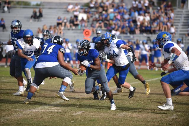 Desert Pines Isaiah Morris (7) runs the ball against South Tahoe during their 3A state semifinal football game played at the Desert Pines football field in Las Vegas on Saturday, Nov. 12, 2016. De ...