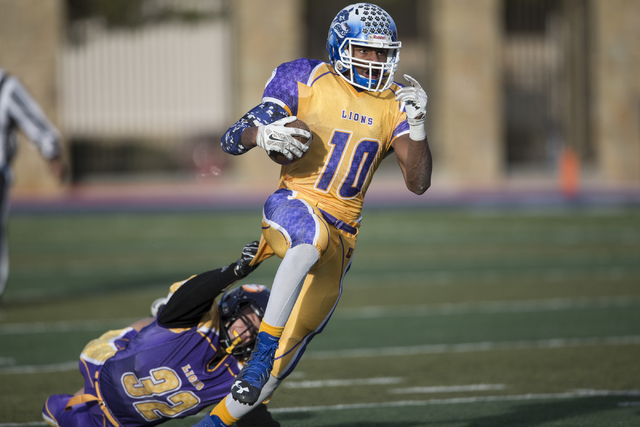 Sunrise All-Stars Frank Harris (10) of Basic avoids a tackle in his run against Sunset All-Starts Jacob Bourgault (32) of Durango in the Lions Club 45th Annual All Star Football Game at Bishop Gor ...