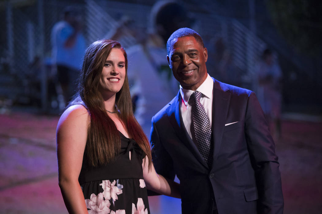 Samantha Pochop, left, is presented with the Female Athlete of the Tear Award by football hall of famer Marcus Allen during the annual Best of Nevada Preps Awards at the Venetian hotel-casino on S ...