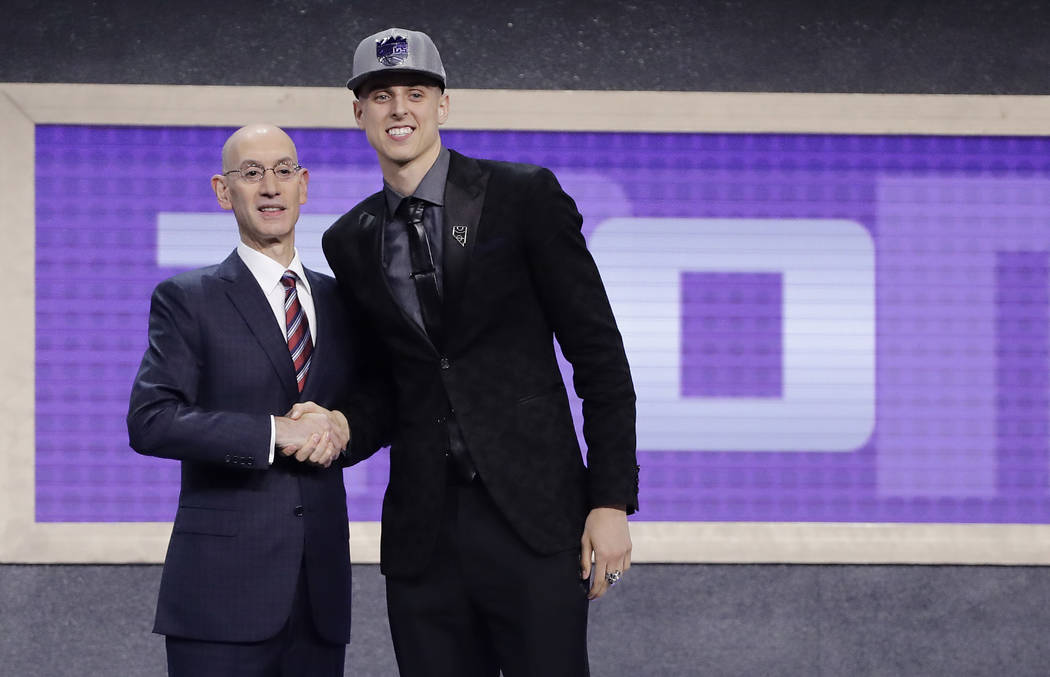 Zach Collins poses for photos with NBA Commissioner Adam silver after being selected by the Sacramento Kings as the 10th pick overall during the NBA basketball draft, Thursday, June 22, 2017, in N ...