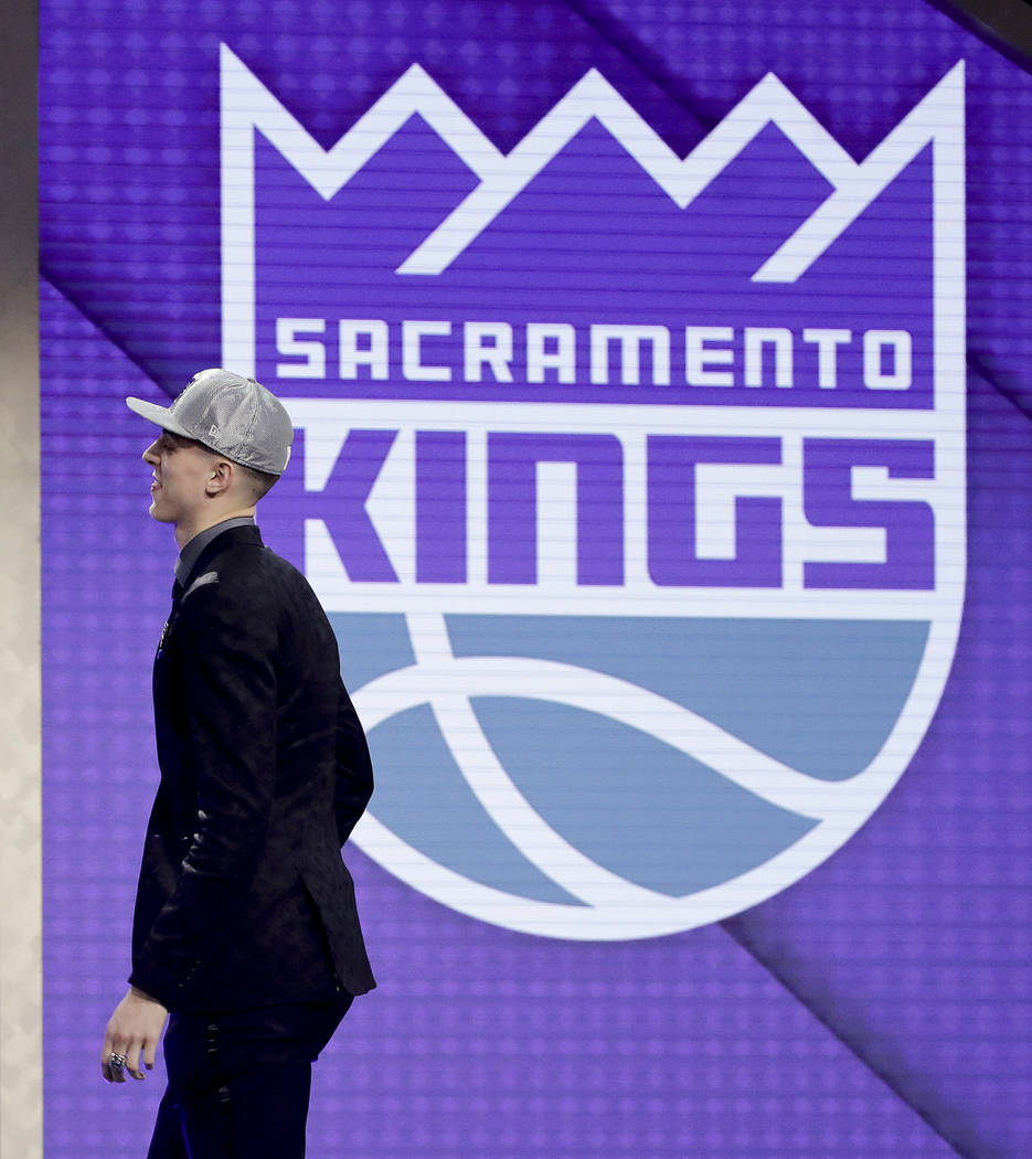 Zach Collins walks up on stage after being selected by the Sacramento Kings as the 10th pick overall during the NBA basketball draft, Thursday, June 22, 2017, in New York. (AP Photo/Frank Franklin II)