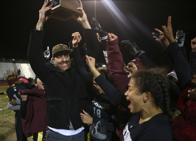Cimarron-Memorial head coach Mark Bailey celebrates with his players after defeating Coronado 24-7 in the Class 4A state championship flag football game at Cimarron-Memorial High School in Las Veg ...