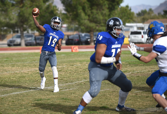 Desert Pines Tyler Williamson (19) throws the ball against South Tahoe during their 3A state semifinal football game played at the Desert Pines football field in Las Vegas on Saturday, Nov. 12, 20 ...