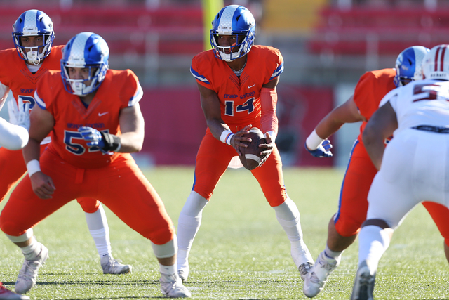 Bishop Gorman's Dorian Thompson-Robinson (14) takes a snap ball against Liberty in the Class 4A state football championship game at Sam Boyd Stadium on Saturday, Dec. 3, 2016, in Las Vegas. Bishop ...