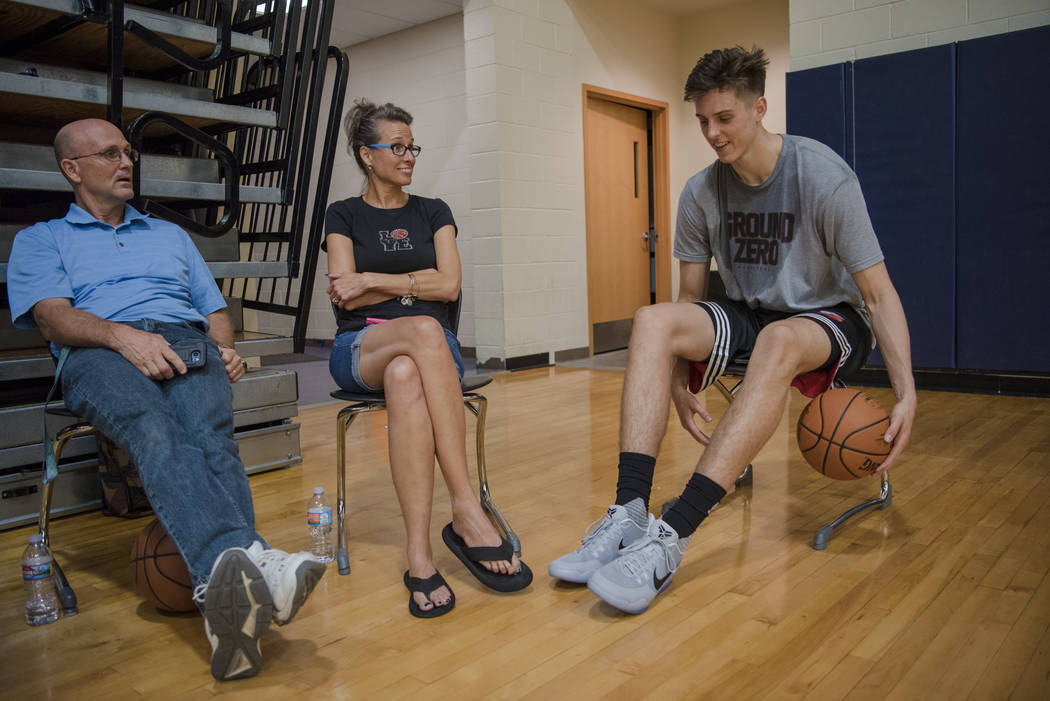 Zach Collins catches up with Heather Collins and Ivan Mitchell after his training session at alma mater Bishop Gorman High School on Friday, June 30, 2017, in L Las Vegas. Morgan Lieberman Las Veg ...