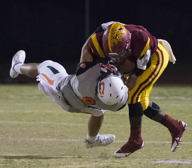 Del Sol's Taariq Flowers (5) is tackled by Chaparral's Devin Gaddy (9) during a football game at Del Sol in Las Vegas, Friday, Sept. 23, 2016. Jason Ogulnik/Las Vegas Review-Journal