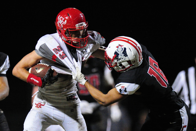 Liberty defensive back Damahny Whittle, right, tackles Arbor View running back Deago Stubbs after Stubbs rushed for a first down in the fourth quarter of their prep at Liberty High School, Friday  ...
