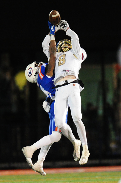 Bishop Gorman cornerback Alex Perry, left, breaks up a pass intended for Faith Lutheran wide receiver Elijah Kothe in the second half of their prep football game at Bishop Gorman High School in La ...