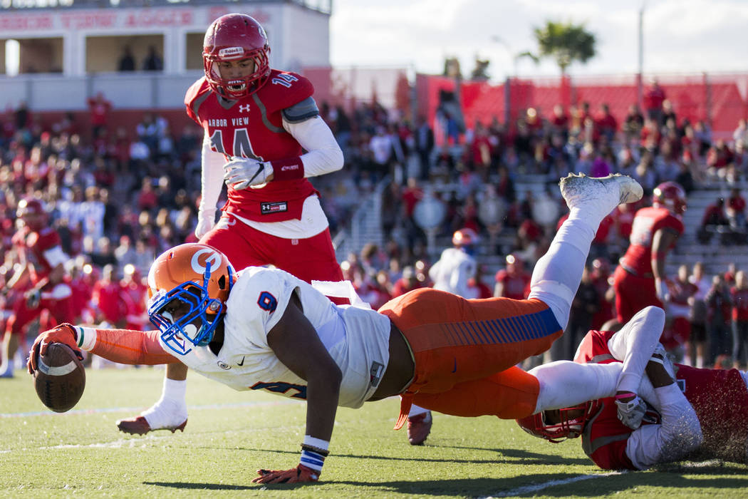 Brevin Jordan (9), dives with the ball during the Sunset Region football final between Bishop Gorman and Arbor View at Arbor View High School, Saturday, Nov. 26, 2016, Las Vegas. Bishop Gorman had ...