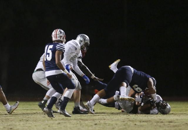 Green Valley running back Julian Hulse (22) is tackled by Liberty's Crishaun Lappin (9) during a football game at Liberty High School in Henderson on Friday, Sept. 30, 2016. Miranda Alam/Las Vegas ...