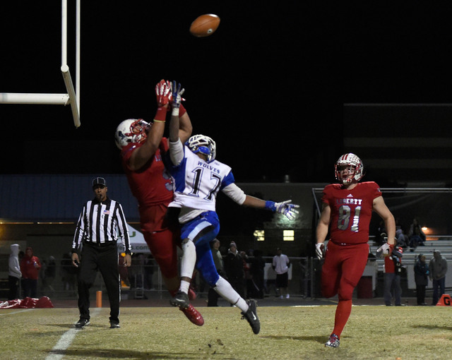 Basic's Quison Owens (17) defends Liberty's Crishaun Lappin during a high school football game at Liberty High School Friday, Nov. 18, 2016, in Henderson. David Becker/Las Vegas Review-Journal Fol ...