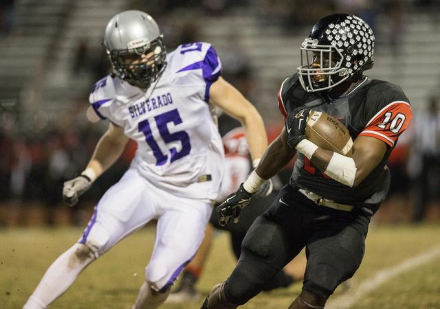 Las Vegas' Elijah Hicks (10) tries to elude Silverado's John Thomas Keller (15) during the Sunrise Region quarterfinals on Friday, Nov. 4, 2016, at Las Vegas High School, in Las Vegas. Benjamin Ha ...