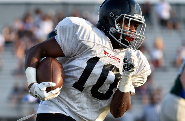 Las Vegas High's Elijah Hicks runs with the ball during a scrimmage against Green Valley at Green Valley High School Friday, Aug. 19, 2016, in Henderson. David Becker/Las Vegas Review-Journal Foll ...