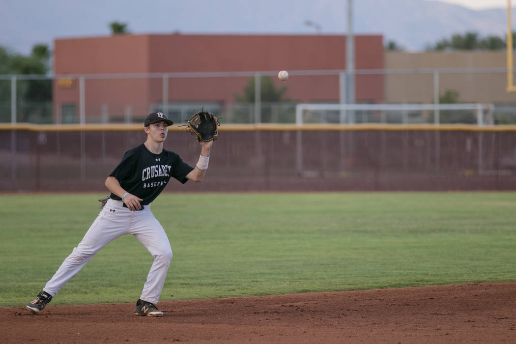Faith Lutheran Crusader Paulshawn Pasqualotto eyeing the ball at shortstop during a game at Faith Lutheran High School on Thursday, July 6, 2017, in Las Vegas. Morgan Lieberman Las Vegas Review-Jo ...