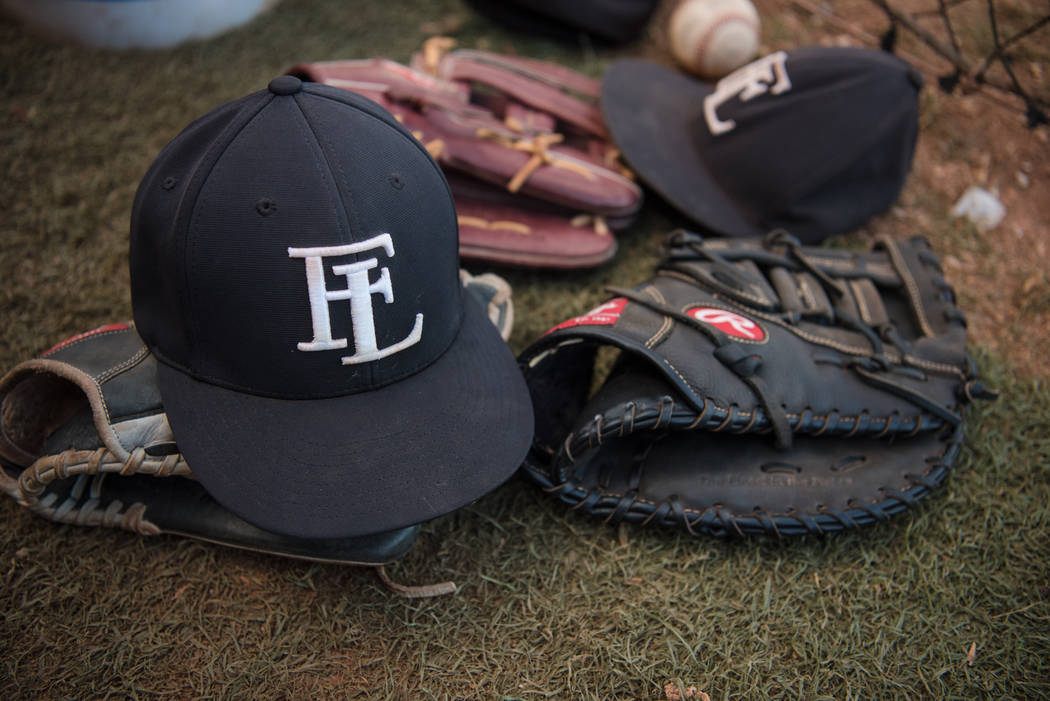 Faith Lutheran hats and baseball mits in the dugout at Faith Lutheran High School on Thursday, July 6, 2017, in Las Vegas. Morgan Lieberman Las Vegas Review-Journal