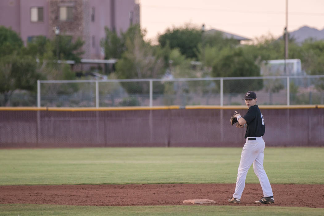 Faith Lutheran Crusader Paulshawn Pasqualotto tossing the ball to the pitcher at shortstop during a game at Faith Lutheran High School on Thursday, July 6, 2017, in Las Vegas. Morgan Lieberman Las ...