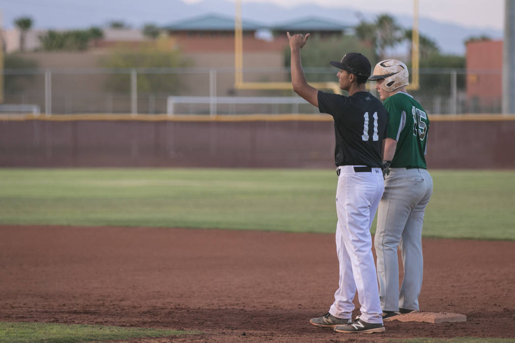 Faith Lutheran Crusader Jacob Ortega signaling a gameplan on first base, during a game at Faith Lutheran High School on Thursday, July 6, 2017, in Las Vegas. Morgan Lieberman Las Vegas Review-Journal