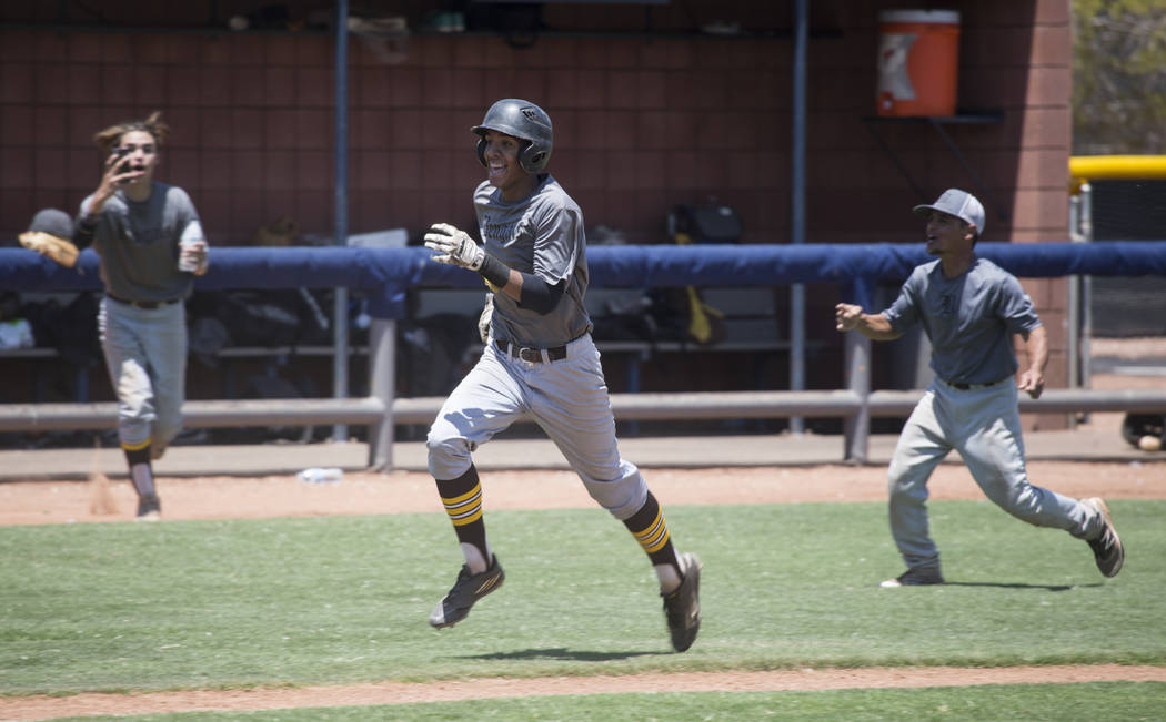 Bengals' Xavier Miller (33) runs to score the winning run against Las Vegas Mustangs in the Connie Mack State Baseball Tournament championship game at the College of Southern Nevada Henderson Camp ...