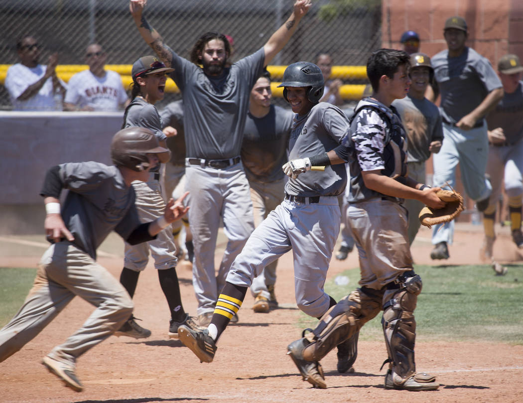 Bengals' Xavier Miller (33), center, runs to score the winning run against Las Vegas Mustangs in the Connie Mack State Baseball Tournament championship game at the College of Southern Nevada Hende ...