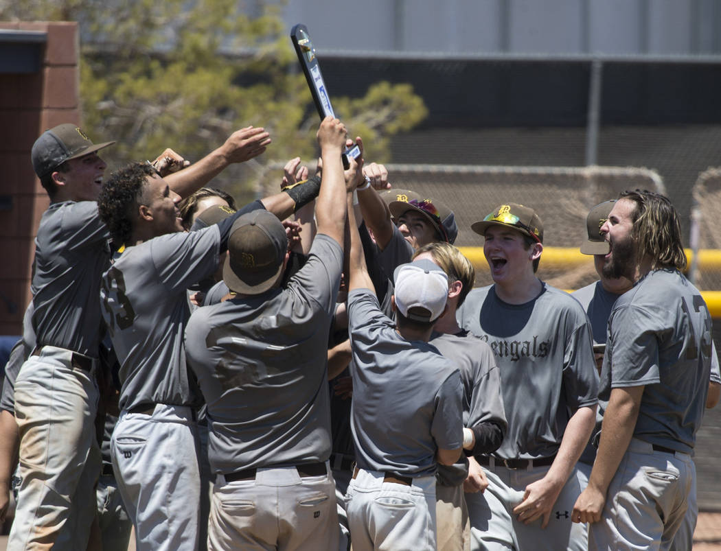 Bengals celebrate their win against the Las Vegas Mustangs in the Connie Mack State Baseball Tournament championship game at the College of Southern Nevada Henderson Campus in Henderson, on Saturd ...