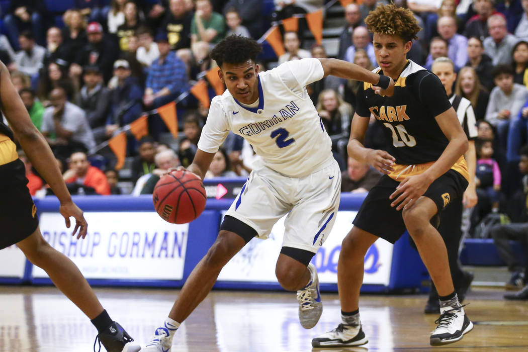 Bishop Gorman Jamal Bey (2) drives to the basket past Clark forward Jalen Hill (20) during a basketball game at Bishop Gorman High School in Las Vegas on Tuesday, Jan. 31, 2017. Clark won 68-62. ( ...