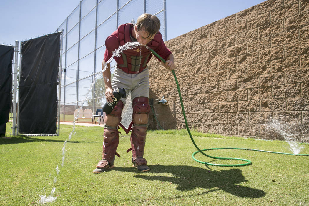Desert Oasis catcher Cole Schaefer rehydrates in-between innings during a practice game at Desert Oasis High School in Las Vegas, Friday, July 21, 2017.  Gabriella Angotti-Jones Las Vegas Review-J ...