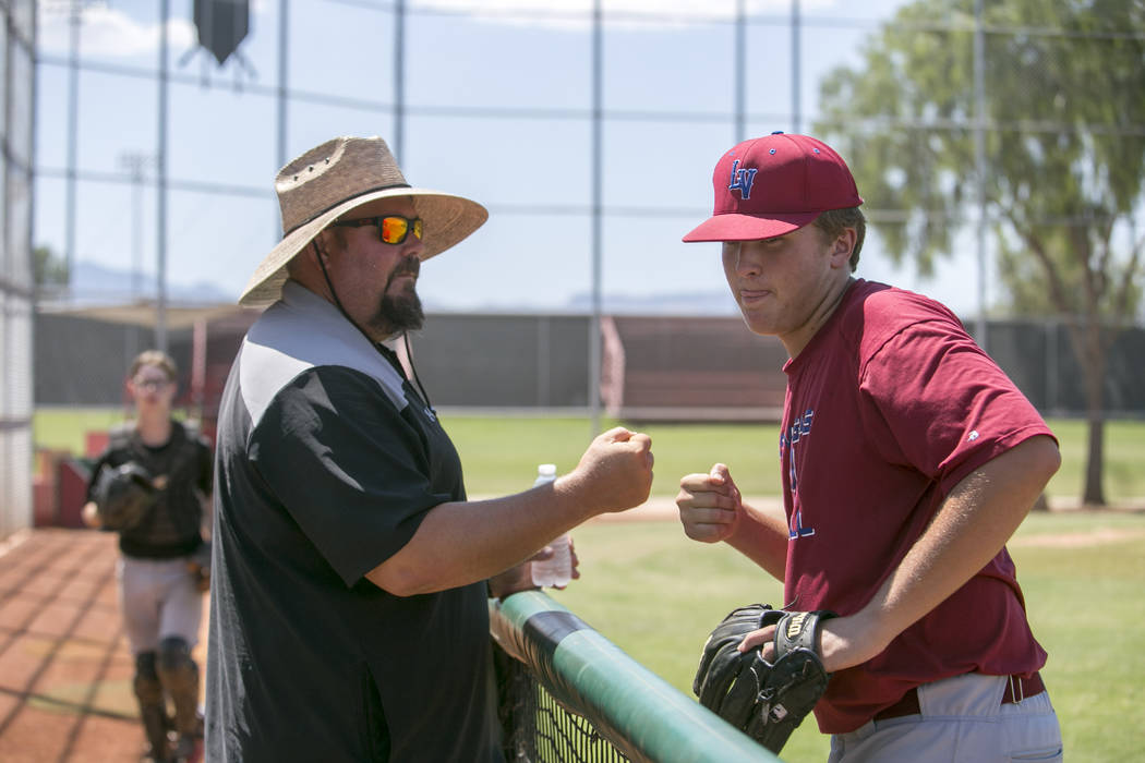 Desert Oasis baseball head coach Paul Buboltz, left, fist bumps pitcher Chaison Miklich during a practice game at Desert Oasis High School in Las Vegas, Friday, July 21, 2017.  Gabriella Angotti-J ...