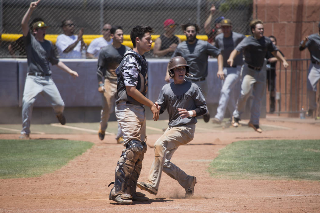 Bengals' Nick DeSoto (10), right, runs to score the tying run run against Las Vegas Mustangs in the Connie Mack State Baseball Tournament championship game at the College of Southern Nevada Hender ...