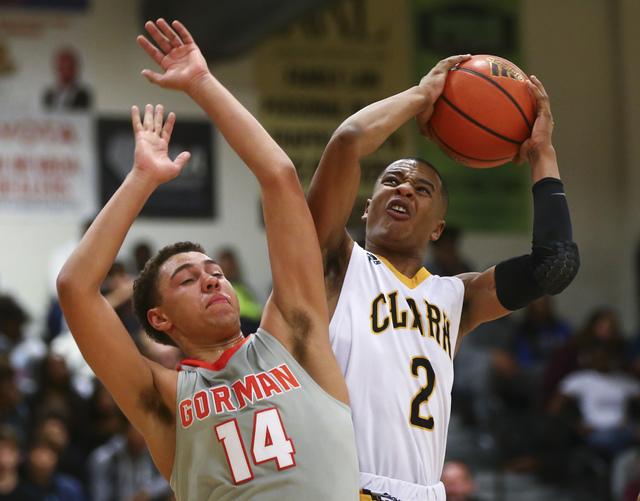 Clark's Sedrick Hammond (2) gets to the basket over Bishop Gorman's Saxton Howard (14) during a basketball game at Clark High School in Las Vegas on Tuesday, Jan. 3, 2017. Bishop Gorman won 70-63. ...
