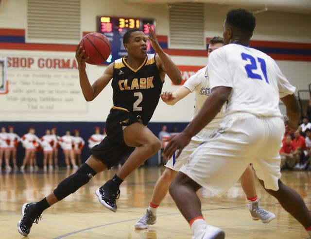 Clark guard Sedrick Hammond (2) drives to the basket past Bishop Gorman guard Christian Popoola (21) during a basketball game at Bishop Gorman High School in Las Vegas on Tuesday, Jan. 31, 2017. C ...