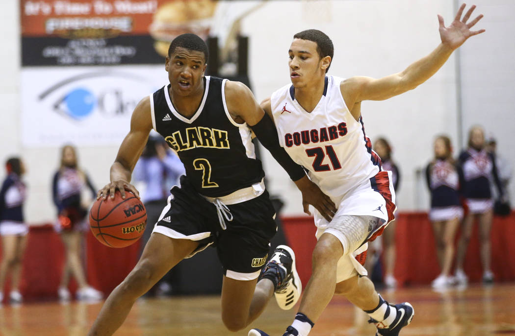 Clark guard Sedrick Hammond (2) drives to the basket against Coronado's Freddy Reeves (21) during the Class 4A boys state basketball semifinals at the Cox Pavilion in Las Vegas on Thursday, Feb. 2 ...
