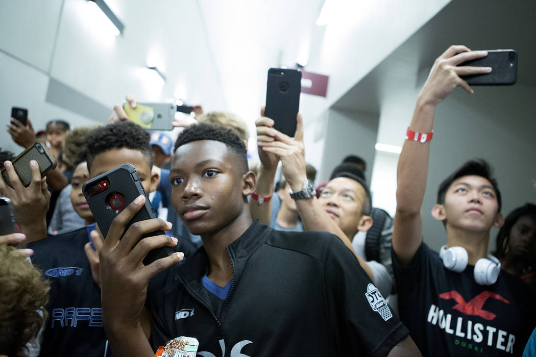 Fans swarm to take photos of LaMelo Ball, coach LaVar Ball and the rest of the Big Baller Brand team after their Adidas Summer Championship AAU tournament game at Cashman Center in Las Vegas on Th ...
